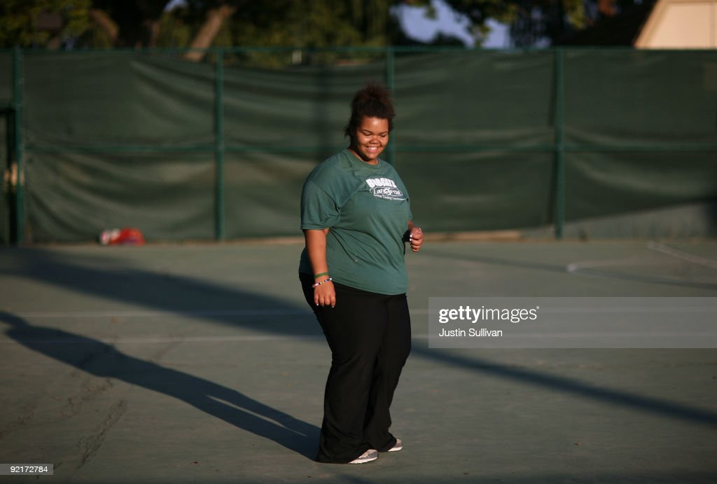 Seventeen year-old Marissa Hamilton laughs with friends during a fitness class at Wellspring Academy October 20, 2009 in Reedley, California. Struggling with her weight, seventeen year-old Marissa Hamilton enrolled at the Wellspring Academy, a special school that helps teens and college level students lose weight along with academic courses. When Marissa first started her semester at Wellspring she weighed in at 340 pounds and has since dropped over 40 pounds of weight in the first two months of the program. According to the Centers for Disease Control and Prevention, 16 percent of children in the US ages 6-19 years are overweight or obese, three times the amount since 1980.