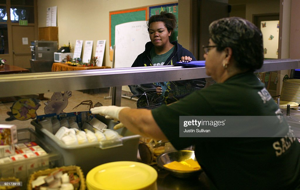 Seventeen year-old Marissa Hamilton (L) waits in line to get a meal at Wellspring Academy October 20, 2009 in Reedley, California. Struggling with her weight, seventeen year-old Marissa Hamilton enrolled at the Wellspring Academy, a special school that helps teens and college level students lose weight along with academic courses. When Marissa first started her semester at Wellspring she weighed in at 340 pounds and has since dropped over 40 pounds of weight in the first two months of the program. According to the Centers for Disease Control and Prevention, 16 percent of children in the US ages 6-19 years are overweight or obese, three times the amount since 1980.