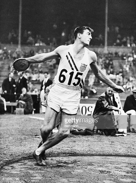 Seventeen-year-old American Bob Mathias hurls the discus during the decathlon event at the 1948 Summer Olympic Games in London.