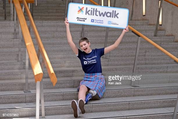 Seventeenyearold amputee Johanna Lambe from Edinburgh who has a rare form of bone cancer but plans to lead all three charity Kiltwalks holds up a...