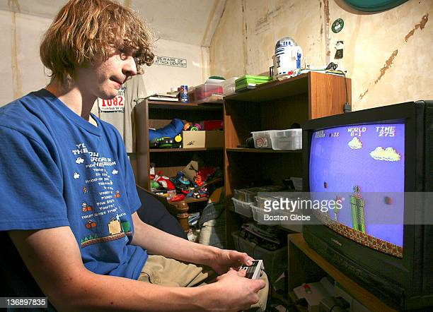Seventeenyearold Andrew Gardikis a Super Mario champ plays the video game in his room