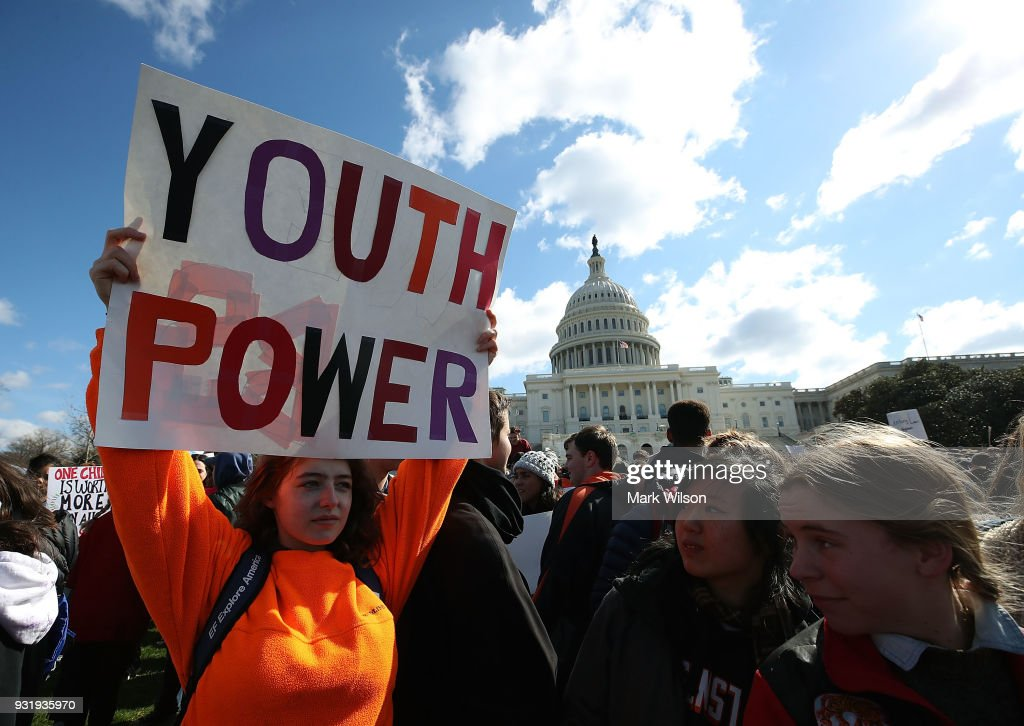 Seventeen-year-old Annie McCasland of Potomac, Maryland holds up a sign during a rally at the U.S. Capitol to urge Congress to take action against gun violence on March 14, 2018 on Capitol Hill in Washington, DC. It was one month ago today that a gunman killed 17 people at Marjory Stoneman Douglas High School in Parkland, Florida.
