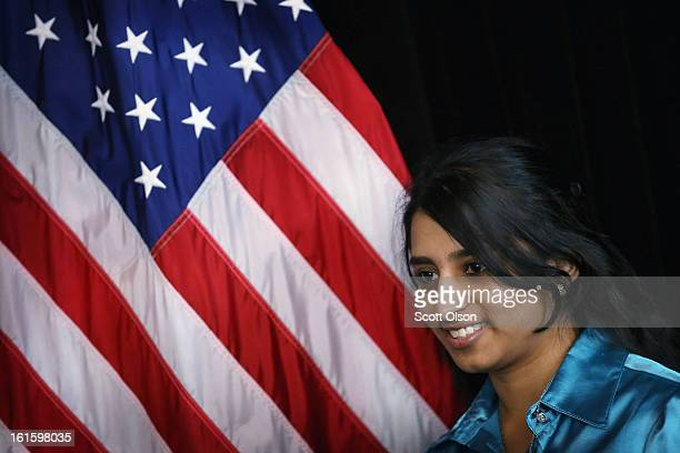 Seventeenyearold Chumandai Shivgobin from Guyana poses next to an American flag after she received a citizenship certificate during a ceremony at the...