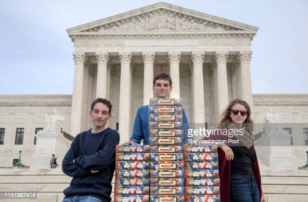 Seventeen-year-old Josh Lafair, a board-game fanatic and political activist, along with his siblings Louis and Rebecca, stack 82 copies of the game...