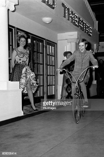 Seventeenyearold model Twiggy has the mindmybike look as she tours the Daily Mail Ideal Home Exhibition at Olympia