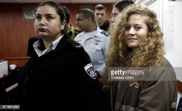 Seventeenyearold Palestinian Ahed Tamimi a wellknown campaigner against Israel's occupation stands for the beginning of her trial in the Israeli...