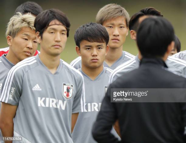 Seventeenyearold Takefusa Kubo listens to Japan football coach Hajime Moriyasu in Toyota Aichi Prefecture on June 2 in national team training for a...