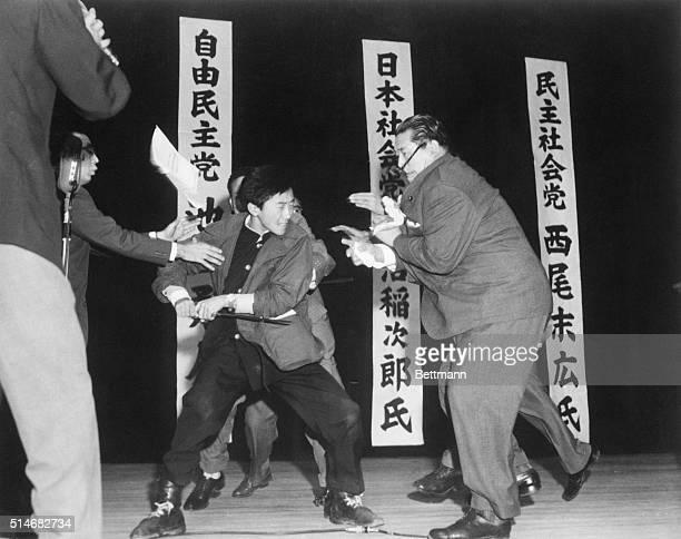 Seventeenyearold Yamaguchi Otoya uses a footlong sword to kill Japan Socialist Party leader Asanuma Inajiro on a public stage in Tokyo Yamaguchi was...