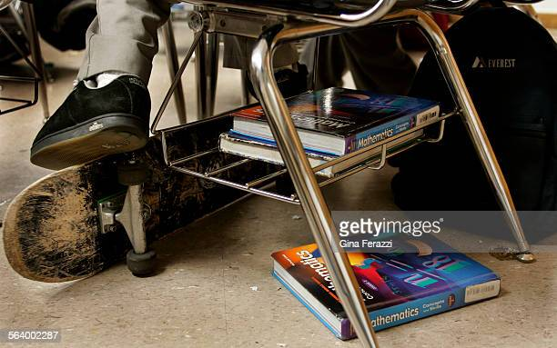 A seventh grade student rests his foot on his skateboard during math class on scientific notation at Virgil Middle School in Koreatown Tuesday Aug...