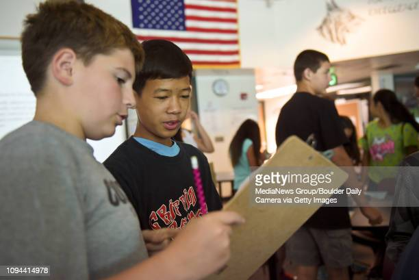 Seventh graders Will Kelly left and Kay Reh work on an assignment with fellow classmates during the BVSD EdVentures summer program at Angevine Middle...