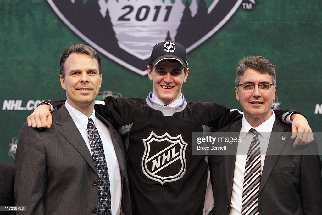 Seventh overall pick Mark Scheifele by the Winnipeg Jets stands at the podium with members of the Winnipeg Jets organization for a photo during day one of the 2011 NHL Entry Draft at Xcel Energy Center on June 24, 2011 in St Paul, Minnesota.