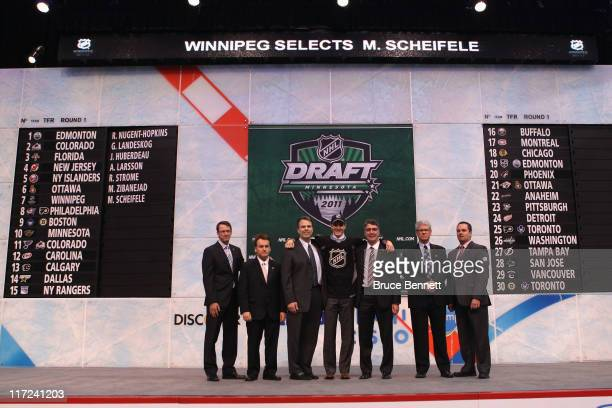 Seventh overall pick Mark Scheifele by the Winnipeg Jets stands at the podium for a photo with members of the Winnipeg Jets organization during day...