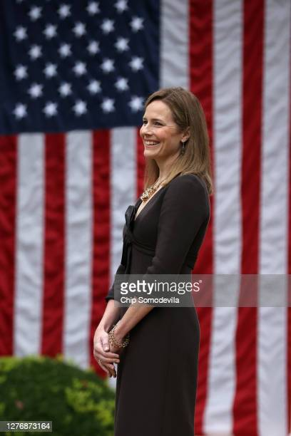 Seventh U.S. Circuit Court Judge Amy Coney Barrett looks on while being introduced by U.S. President Donald Trump as his nominee to the Supreme Court...
