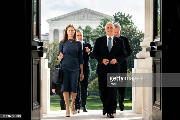 Seventh U.S. Circuit Court Judge Amy Coney Barrett, President Donald Trump's nominee for the U.S. Supreme Court, and Vice President Mike Pence arrive...