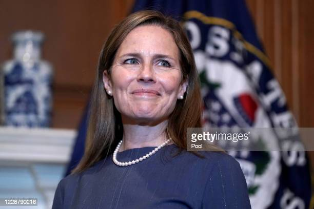 Seventh U.S. Circuit Court Judge Amy Coney Barrett, President Donald Trump's nominee for the U.S. Supreme Court, meets with Sen. John Thune as she...