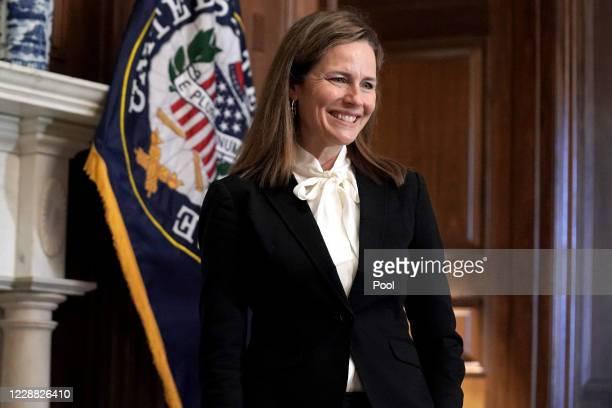 Seventh U.S. Circuit Court Judge Amy Coney Barrett, President Donald Trump's nominee for the U.S. Supreme Court, meets with Sen. Marsha Blackburn as...