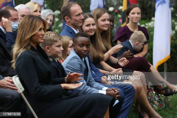 Seventh US Circuit Court Judge Amy Coney Barrett's family including husband Jesse Barrett and their seven children watch as President Donald Trump...