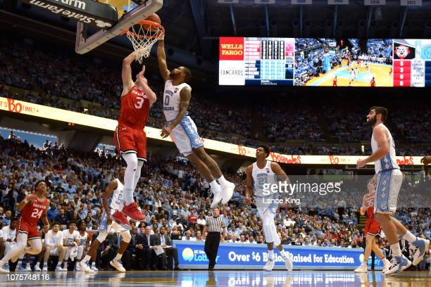 Seventh Woods of the North Carolina Tar Heels blocks a shot by Jon Axel Gudmundsson of the Davidson Wildcats in the first half at Dean Smith Center...