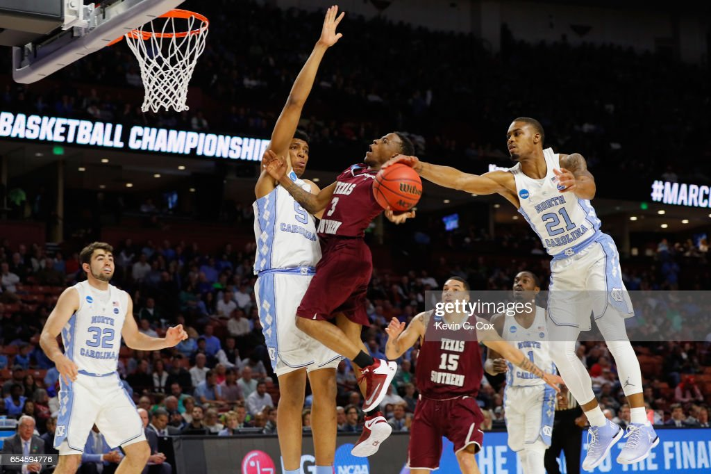 Seventh Woods #21 of the North Carolina Tar Heels blocks a shot by Demontrae Jefferson #3 of the Texas Southern Tigers in the first half during the first round of the 2017 NCAA Men's Basketball Tournament at Bon Secours Wellness Arena on March 17, 2017 in Greenville, South Carolina.
