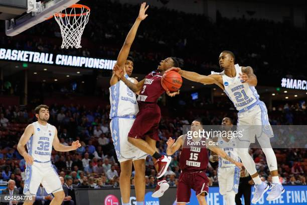 Seventh Woods of the North Carolina Tar Heels blocks a shot by Demontrae Jefferson of the Texas Southern Tigers in the first half during the first...