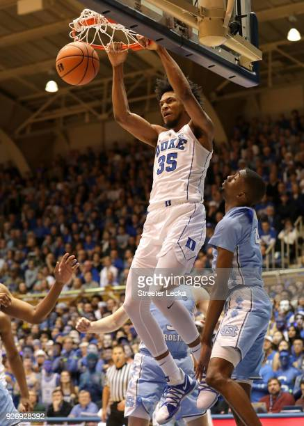 Seventh Woods of the North Carolina Tar Heels watches as Marvin Bagley III of the Duke Blue Devils dunks the ball during their game at Cameron Indoor...
