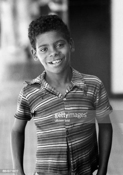 Seventies black and white photo people boy 12 to 15 years Brazilian mulatto shorthaired smiling Tshirt