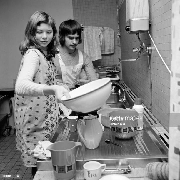 Seventies black and white photo people physical handicap school school lessons cooking instruction schoolgirl 12 to 14 years and schoolboy 13 to 15...