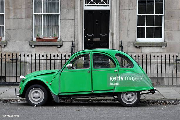 seventies green car in front of house - number 2 stock pictures, royalty-free photos & images