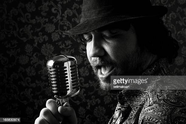 Seventies rock star singing on old fashioned microphone
