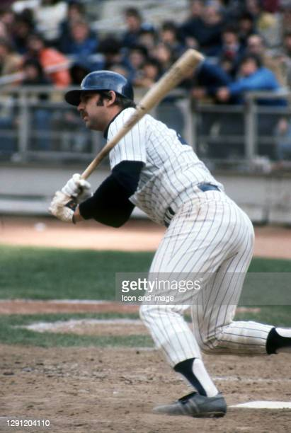 Seven-time All-Star catcher for the New York Yankees, Thurman Munson connects with the ball at Yankee Stadium in the Bronx, NY, during his 1976 MVP...