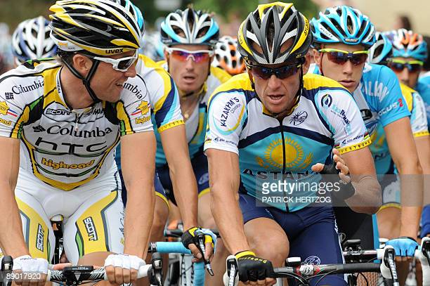 Seventime Tour de France winner and Kazakh cycling team Astana 's Lance Armstrong of the United States speaks with US cycling Team ColumbiaHigh Road...