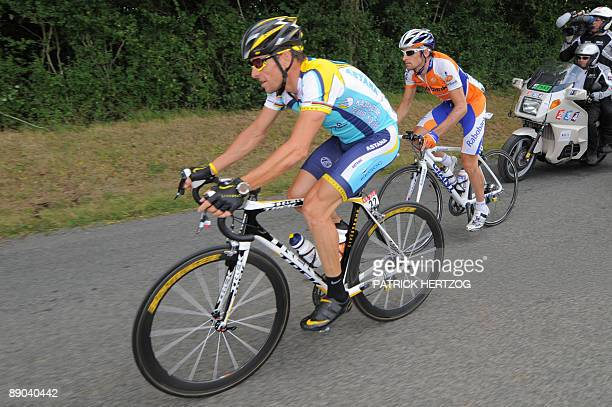 Seventime Tour de France winner and Kazakh cycling team Astana 's Lance Armstrong of the United States rides with 87th Giro cycling race winner Dutch...