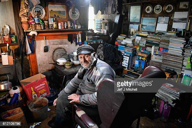 Seventy eight year old crofter Eric Ibister sits in his armchair at his home in Hametoun on the Island of Foula September 30 2016 in Foula Scotland...