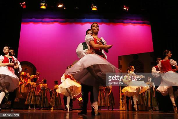 Seventyfive Jordanian dancers perform the comic ballet 'Coppelia' October 22 2014 in Amman Jordan The performance was choreographed by Jordanian...