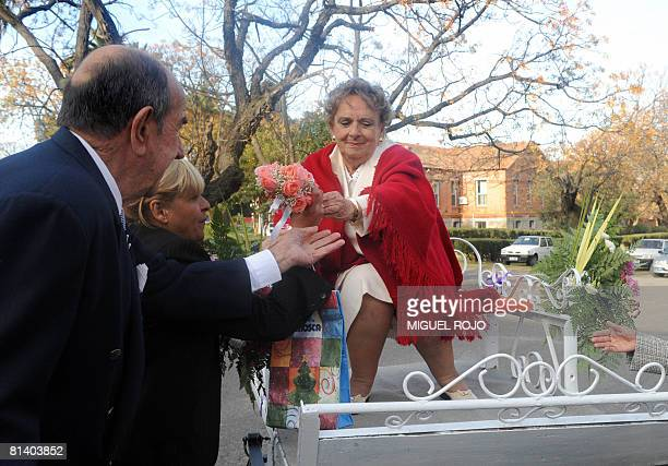 Seventysevenyearold Nilsa Noble arrives in a cart pulled by a pony to wed Alfredo Maciel at the public geriatric hospital Pieyro del Campo in which...