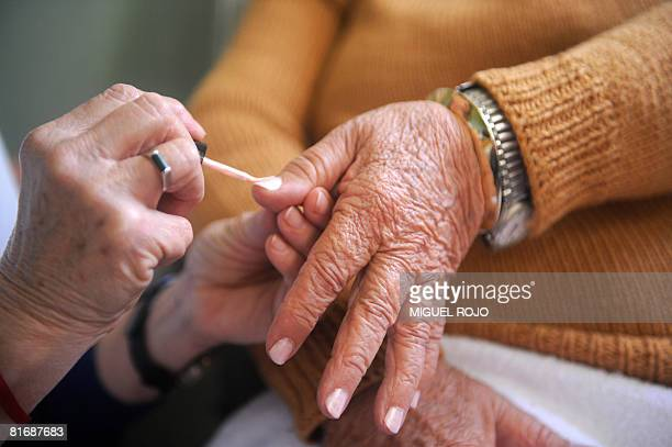 Seventysevenyearold Nilsa Noble has a manicure for her wedding to eightytwoyearold Alfredo Maciel at the public geriatric hospital Pieyro del Campo...