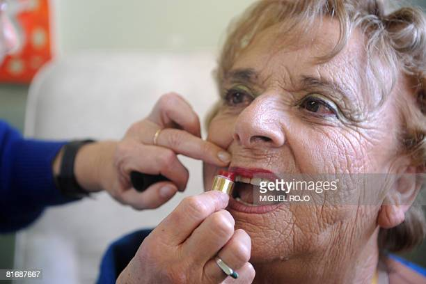 Seventysevenyearold Nilsa Noble is assisted with her makeup for her wedding to eightytwoyearold Alfredo Maciel at the public geriatric hospital...
