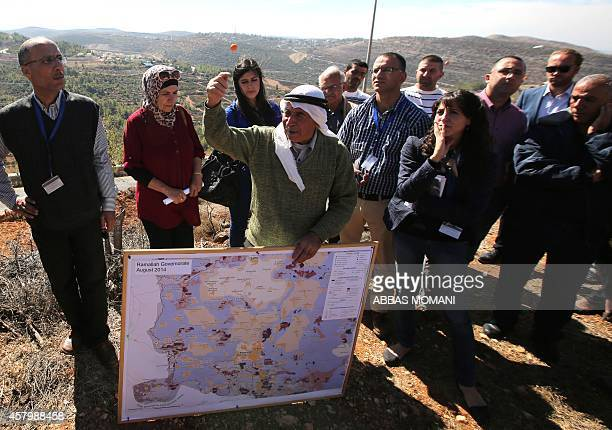 BENHAIDA Seventyyear old Palestinian farmer Abbas Yusef explains to United Nations officials and foreign supporters of Palestinian rights the...