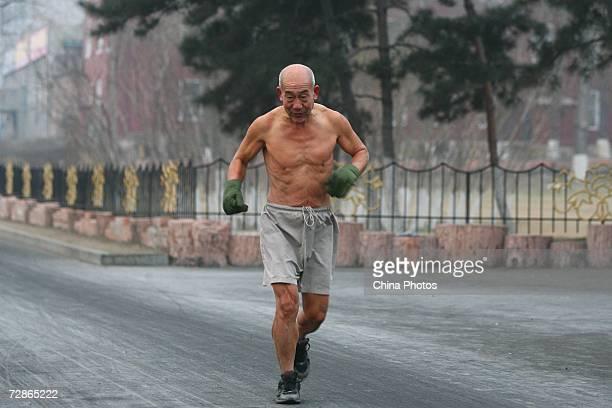 Seventyyearold Chinese senior citizen Dong Yaoge stripped to the waist runs at a temperature around 4 degree Fahrenheit below zero on December 21...