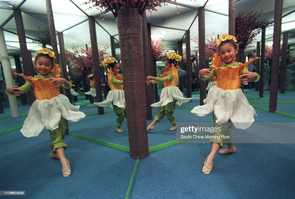 Seven-year old ballet dancer Jocelyn Mui Ji practises her