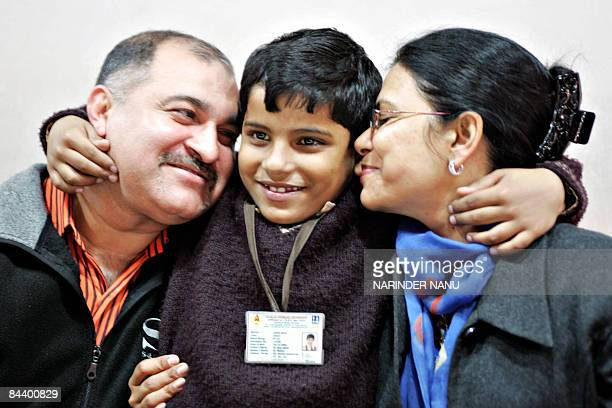 Sevenyear old child singer Kartik Abrol hugs his parents Ajay Abrol and Rekha Abrol during a press conference in Amritsar on January 22 2009 Kartik a...
