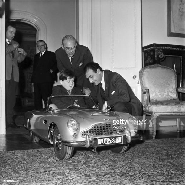 Sevenyear old Ian Heggie the son of Aston Martin's Deputy Managing Director test drives a toy Aston Martin DB5 at the Iranian Embassy in London 20th...