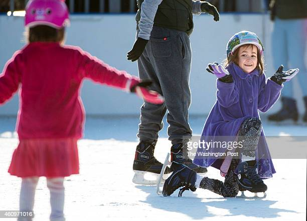 Sevenyearold Aspen Albright curtsies to her sister Aria Albright age 5 after trying a big move learning to ice skate at Quiet Waters Park Ice Rink in...