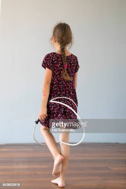 A sevenyearold girl holds a jump rope in her hands on August 07 2017 in Bonn Germany
