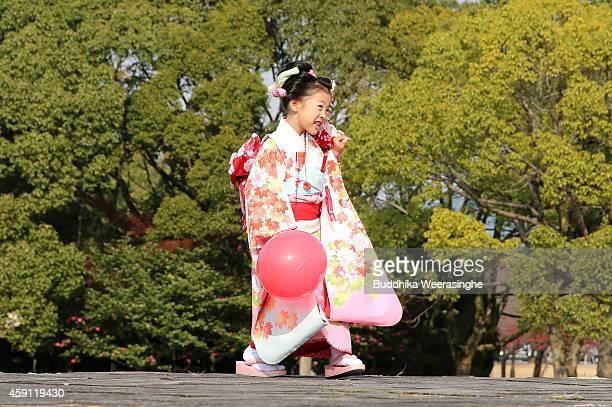Sevenyearold girl Rio Araki wears a traditional kimono costume during the ShichiGoSan Festival on November 17 2014 in Himeji Japan The ShichiGoSan...