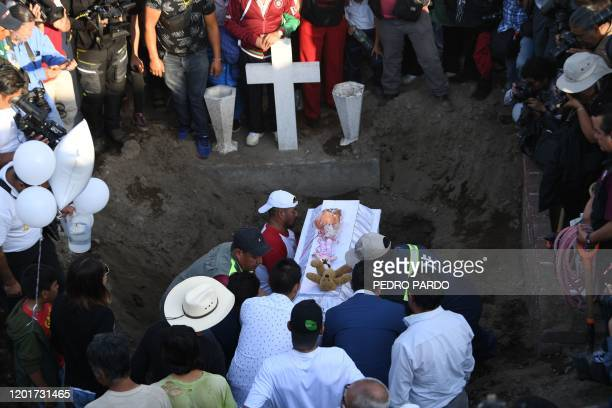 TOPSHOT A sevenyearold girl whose body was found over the weekend with signs of torture is laid to rest at the cemetery in Santiago Tulyehualco...