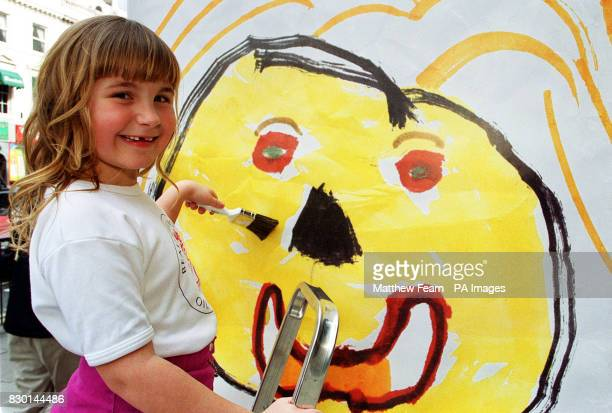 Sevenyearold Hannah Mills from Preston Lancashire pastes her awardwinning poster of her mother on to its first site on Kensington High Street London...