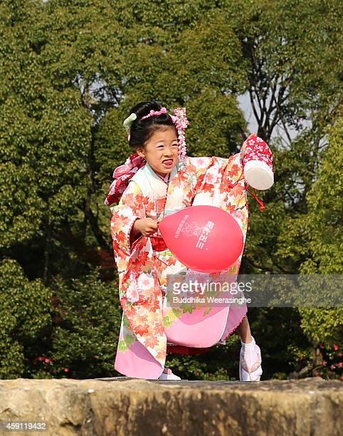 Sevenyearold named Rio Araki is dressed in a traditional kimono costume during the ShichiGoSan Festival on November 17 2014 in Himeji Japan The...