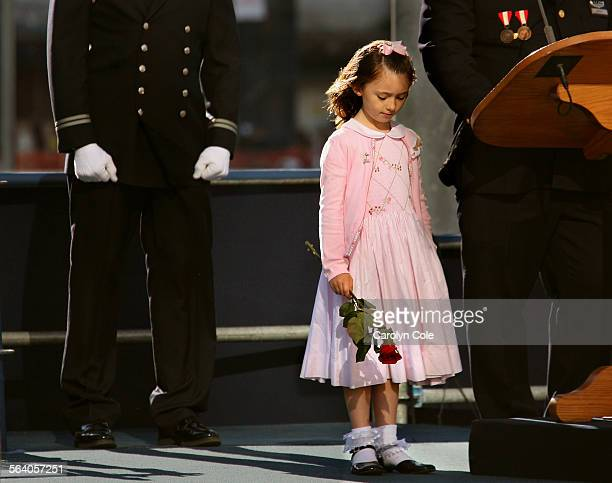 Seven–year–old Patricia Smith lost her mother Moira Smith, a New York City Police Officer, on September 11th. She holds a rose in remembrance of her...