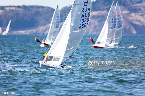 several 505 racing dinghys in a competition - sail boom stock pictures, royalty-free photos & images